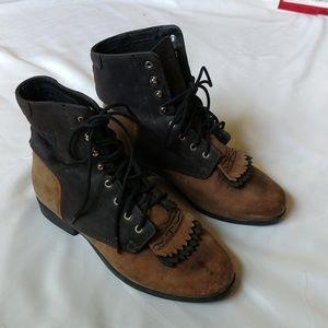 Ariat western work roper boots.